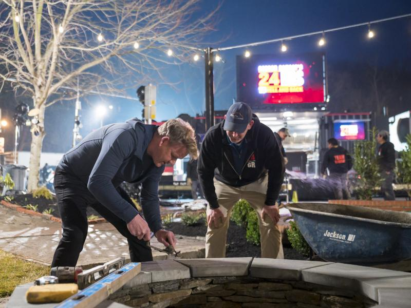 Gordon Ramsay builds a firepit in front of the Little Market Cafe