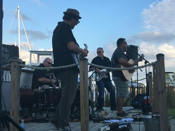 band playing on a pier
